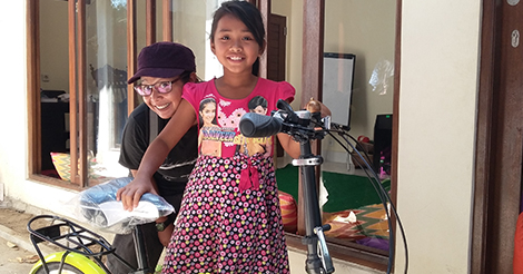 Our staff member Manda donating a bike to Mira